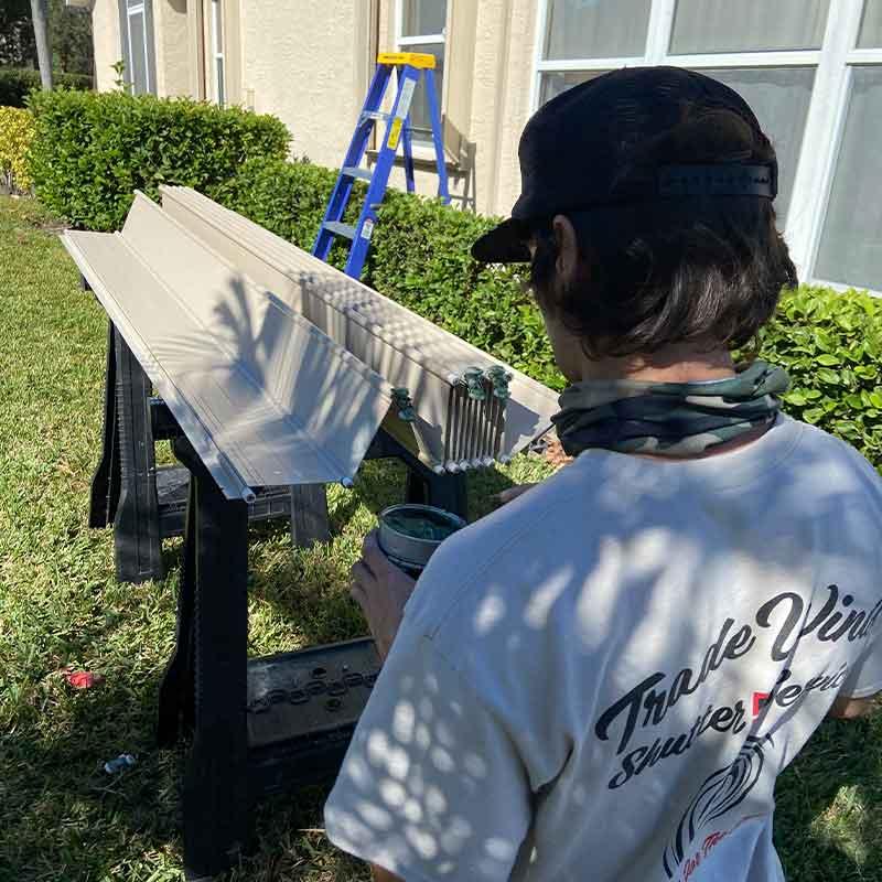 A hurricane shutter repair technician working in Port St. Lucie, FL